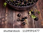 black currant on a wooden... | Shutterstock . vector #1139591477