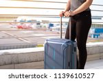 young woman with suitcase in... | Shutterstock . vector #1139610527