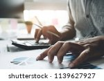 accountant working on... | Shutterstock . vector #1139627927