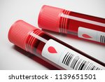 two test tube of red blood... | Shutterstock . vector #1139651501