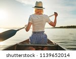rearview of a young woman... | Shutterstock . vector #1139652014