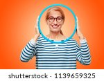 senior beautiful woman with a... | Shutterstock . vector #1139659325