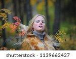 beautiful blonde in an autumn... | Shutterstock . vector #1139662427