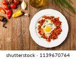shakshouka  dish of eggs...   Shutterstock . vector #1139670764