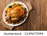 roast chicken whole. served on...   Shutterstock . vector #1139677094