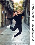 young bearded man jumping in... | Shutterstock . vector #1139682071