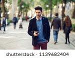 attractive man in the street... | Shutterstock . vector #1139682404
