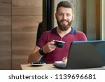 smiling hipster keeping coffee... | Shutterstock . vector #1139696681