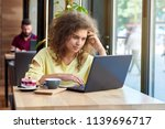 curly student studying  working ... | Shutterstock . vector #1139696717