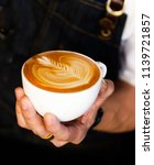 close up barista hand making a... | Shutterstock . vector #1139721857
