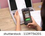 qr code scanning concept.hands... | Shutterstock . vector #1139756201