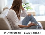 jealous woman sitting on sofa... | Shutterstock . vector #1139758664