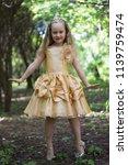 a beautiful little blonde girl... | Shutterstock . vector #1139759474