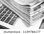 newspapers and laptop. pile of... | Shutterstock . vector #1139786177