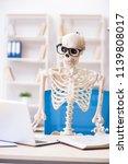 skeleton businessman working in ... | Shutterstock . vector #1139808017