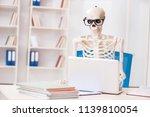 skeleton businessman working in ... | Shutterstock . vector #1139810054