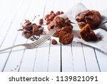 broken chocolate muffin and... | Shutterstock . vector #1139821091