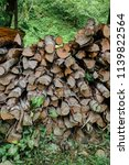 pile of firewood backgrounds... | Shutterstock . vector #1139822564