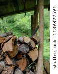 pile of firewood backgrounds... | Shutterstock . vector #1139822591