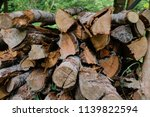 pile of firewood backgrounds... | Shutterstock . vector #1139822594