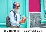 trendy senior man using music... | Shutterstock . vector #1139865104