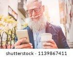 happy senior man using... | Shutterstock . vector #1139867411