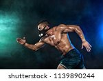 strong athletic man sprinter in ... | Shutterstock . vector #1139890244
