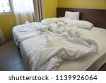 crumpled bed in the hotel.... | Shutterstock . vector #1139926064