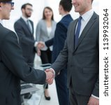 two businessmen handshaking ... | Shutterstock . vector #1139932064