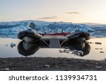 sightseeing boat tied down near ... | Shutterstock . vector #1139934731