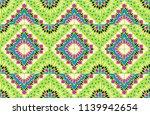 ikat geometric folklore... | Shutterstock .eps vector #1139942654