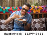 latin man traveling in tulum ... | Shutterstock . vector #1139949611