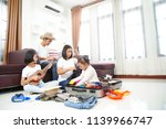 happy asian family using laptop ... | Shutterstock . vector #1139966747