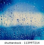 Drops Of Rain On Blue Glass...