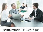 client talking with the staff... | Shutterstock . vector #1139976104