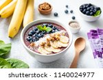 acai smoothie bowl topped with... | Shutterstock . vector #1140024977