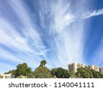 Small photo of beautiful wispy winter cloud formation over the city of Arad in Israel