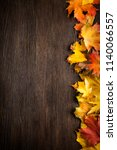 autumn leaf on wood black... | Shutterstock . vector #1140066557