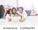 happy asian family and little... | Shutterstock . vector #1140066581