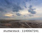 wind farms on coastal beaches... | Shutterstock . vector #1140067241