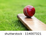 Cricket ball resting on a...