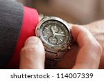 businessman checking the time... | Shutterstock . vector #114007339