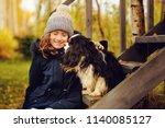 autumn portrait of happy kid... | Shutterstock . vector #1140085127