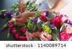 florist girl makes a floral box ... | Shutterstock . vector #1140089714