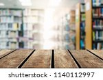 wood table on blur background... | Shutterstock . vector #1140112997