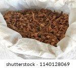 pile of dried coconut husk peel ... | Shutterstock . vector #1140128069