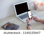 women using phone on work desk... | Shutterstock . vector #1140135647