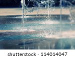 water stream splashing on ground | Shutterstock . vector #114014047