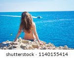 image of a back of one... | Shutterstock . vector #1140155414