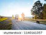playful family running and... | Shutterstock . vector #1140161357